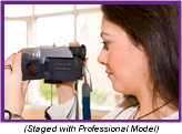 Woman operating handheld personal digital camera (Staged with Professional Model).