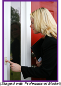 Woman pushing the doorbell on a frontporch of a house (Staged with Professional Model).